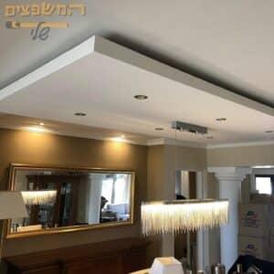 שדרוג בית פרטי בהנמכת תקרה תאורה נסתרת צבע משי מיוחד לקירות ועוד